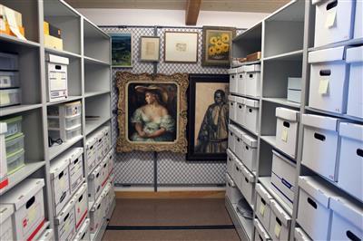 archival boxes on high-density mobile shelving and artwork hanging on art rack