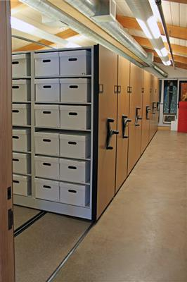 File boxes on compact mobile shelving