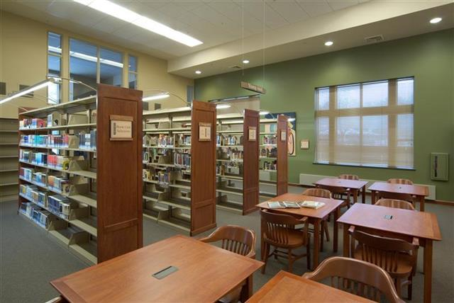 Cantilever Library Shelving With Custom Graphic End Panels