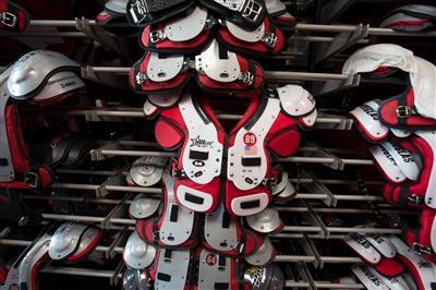 Overhanging football shoulder pad storage at Stanford University