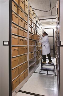 Mobile shelving holding bulk boxes of evidence storage