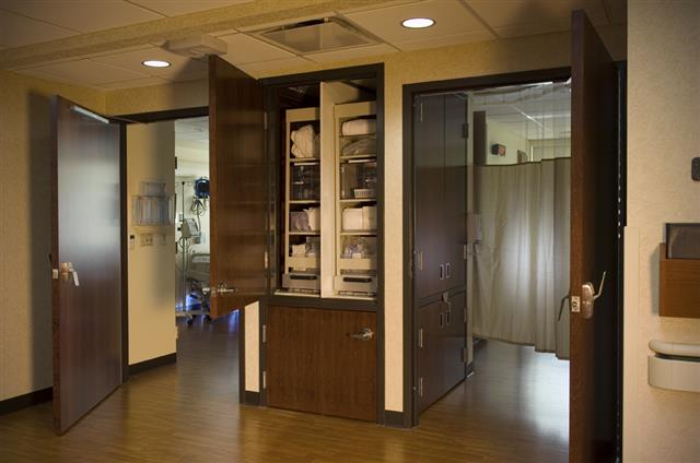 Side by side pull-out cabinets provide storage for sterile supplies ...