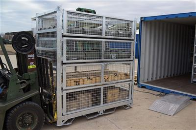 Large SharkCage being transported by Forklift into Storage container for Deployment