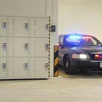 Gear Storage for Evidence Technicians in Locker Units at the Police Car Port